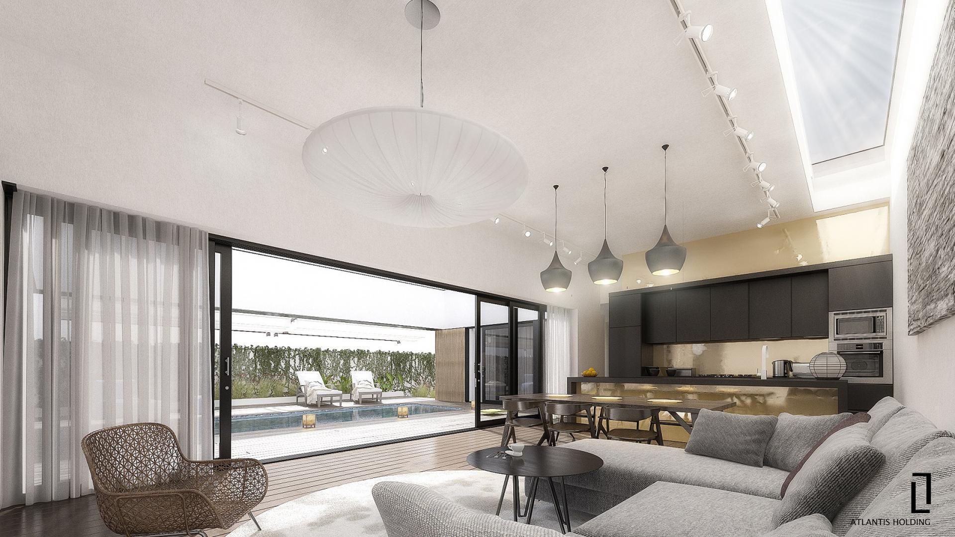 вътрешен поглед на хол / трапезария с изглед към вътрешен частен двор с басейн